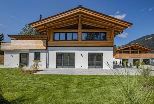exclusive garden suite in a central location with a view of the Hahnenkamm