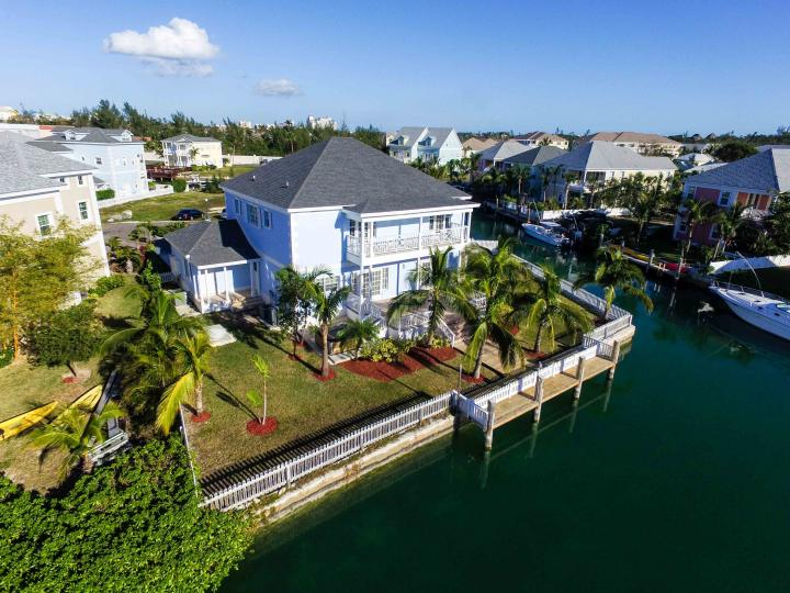 For sale is an exclusive and brand new canal front home in Sandyport