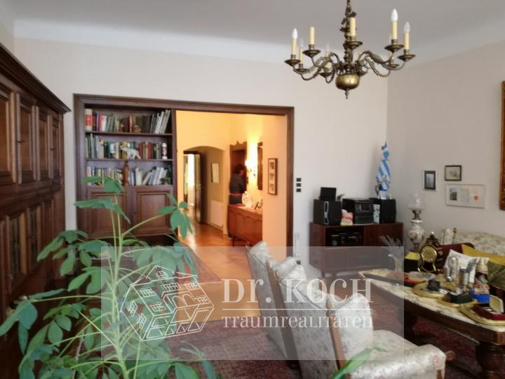 Existing multi-family house with business premises, apartment and expandable attic