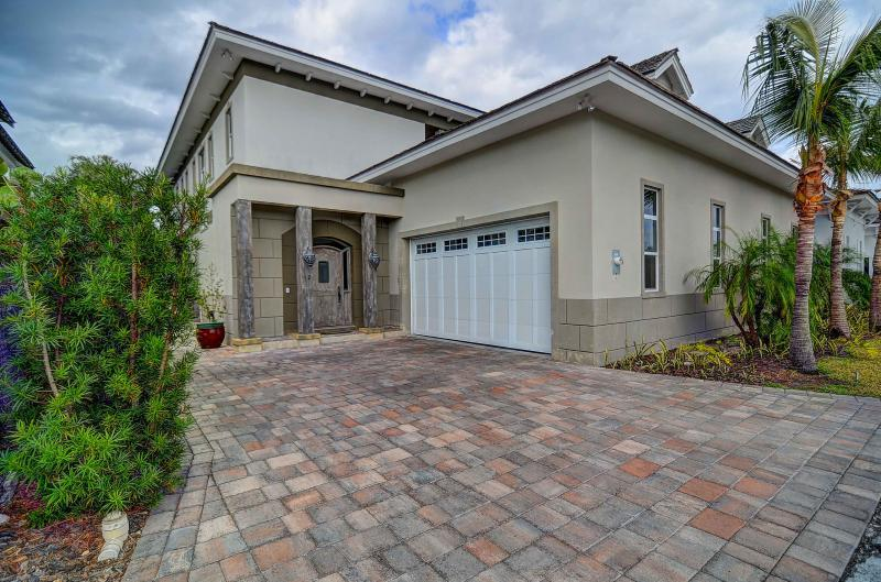 Newly canal front home in the luxury gated community of Old Fort Bay